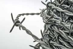 Barbed wire spirals with selective focus. For blur effects royalty free stock photography
