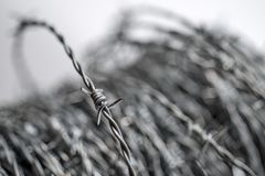 Barbed wire spirals with selective focus. For blur effects stock images