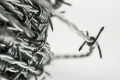 Barbed wire spirals with selective focus. For blur effects stock photography