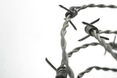 Barbed wire spirals with selective focus. For blur effects stock photos