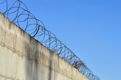Barbed wire stretched along the brick painted walls Royalty Free Stock Photos