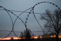 Barbed wire at the sunset. Background Royalty Free Stock Photos
