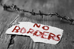 Barbed wire and text no borders Stock Photos