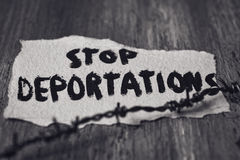Barbed wire and text stop deportations Stock Images
