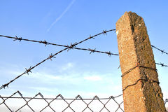 The barbed wire in two rows as protection against unauthorized entry into private territory Stock Image