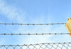 The barbed wire in two rows as protection against unauthorized entry into private territory stock photos