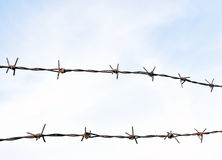 The barbed wire in two rows as protection against unauthorized entry into private territory Stock Photo