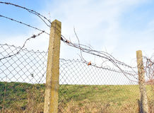 The barbed wire in two rows as protection against unauthorized entry into private territory Royalty Free Stock Images