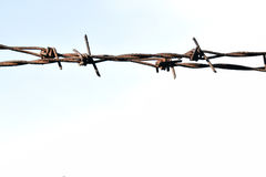 The barbed wire in two rows as protection against unauthorized entry into private territory Royalty Free Stock Photos