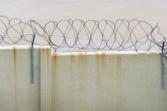 Barbed wire on wall Royalty Free Stock Image