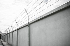 Barbed wire wall against the sky Stock Photography