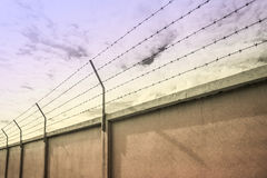 Barbed wire wall against the sky Royalty Free Stock Images