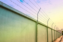 Barbed wire wall against the sky Stock Image