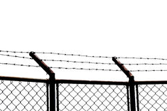 Barbed wire with white background. Chain link fence with barbed wire Stock Photo