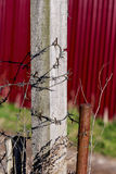 Barbed wire on a wooden pole Royalty Free Stock Photos