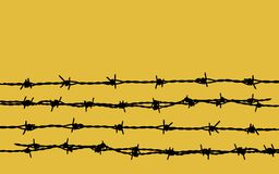 Barbed wire on yellow Royalty Free Stock Photo