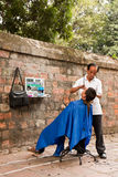 Barbeiro da rua Foto de Stock Royalty Free