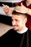 Barbeiro e cliente Fotografia de Stock Royalty Free
