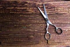 Barbeiro e salão de beleza profissionais à moda, tesouras do cabelo, C.A. do corte de cabelo Fotos de Stock Royalty Free