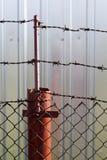 Barbelé et la barrière Photographie stock libre de droits