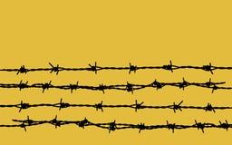 Barbelé sur le jaune Photo libre de droits