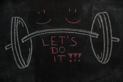 Free Barbell And Let`s Do It Text On Black Chalkboard Royalty Free Stock Photos - 94498918