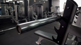 Barbell bar without plates, high quality equipment, gym maintenance, closeup. Stock photo royalty free stock photo