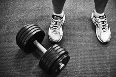 Barbell and feet Stock Photos