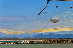 Barbell fishing shed anf fishing net at the river mouth. Barbell fishing shed at the mouth of the Arno rivern fishing shed barbell fishing balancing fishing hut Stock Image