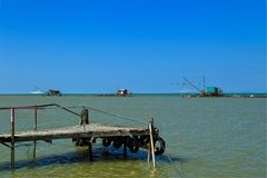 Barbell fishing shed or fishing hut at the river mouth. Barbell fishing shed at the mouth of the Arno rivern fishing shed barbell fishing balancing fishing hut Stock Photography