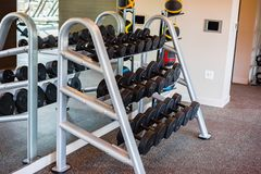 Barbell free weights on rack stock photography