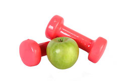 Barbell with green apple Royalty Free Stock Photos