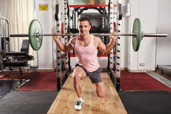 Barbell lunges in the gym Royalty Free Stock Images