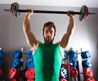 Barbell man workout fitness at weightlifting gym Royalty Free Stock Images