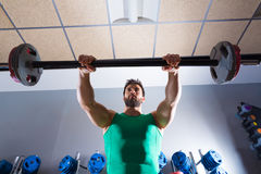 Barbell man workout fitness at weightlifting gym Stock Photography