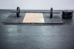 A barbell next to weights Royalty Free Stock Photos