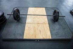A barbell next to weights Stock Photo