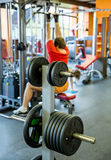 Barbell plates holder in gym Stock Images
