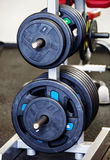 Barbell plates holder in gym Stock Photo
