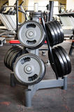 Barbell plates rack Royalty Free Stock Photos