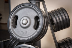 Barbell plates rack Royalty Free Stock Photo