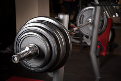 Barbell ready to workout. Indooors, shallow DOF Royalty Free Stock Photography