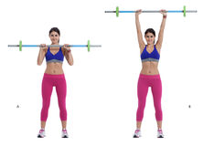 Barbell shoulder press. Step by step instructions: With your feet shoulder-width apart, position a bar on your upper chest, gripping it with hands just wider Royalty Free Stock Photo