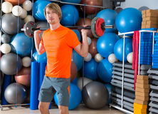 Barbell squats blond man at gym exercise Royalty Free Stock Photo