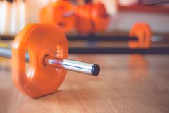 Barbell for Urethane Free Weight Set Body Pump. In fitness stock photo