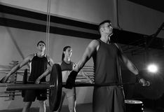 Barbell weight lifting group workout exercise gym Stock Photos