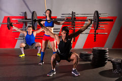 Barbell weight lifting group workout exercise gym Stock Images