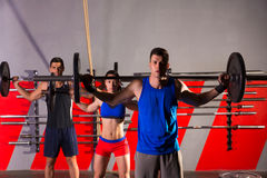 Barbell weight lifting group workout exercise gym Stock Photo