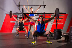 Barbell weight lifting group workout exercise gym Royalty Free Stock Image