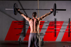 Barbell weight lifting man rear view workout gym Royalty Free Stock Image